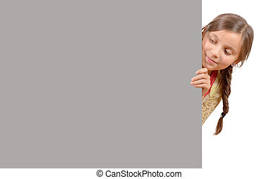 Beautiful young girl with a blank poster isolated on white background