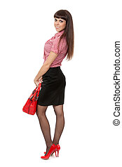 Beautiful young girl with a fashionable red handbag
