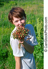 girl with aromatic wild strawberry