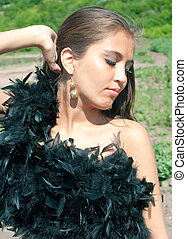 young girl with black boa