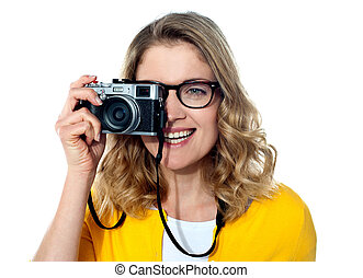 Beautiful young girl with camera