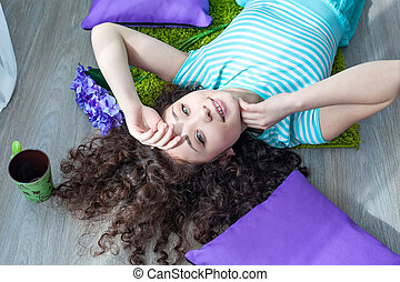 Beautiful young girl with curly hair