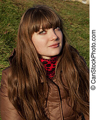 beautiful young girl with dark hair and a brown coat