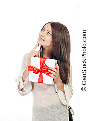 Beautiful young girl with gift