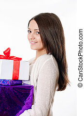 Beautiful young girl with gifts
