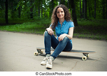 Beautiful young girl with longboard