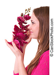 Beautiful young girl with orchid