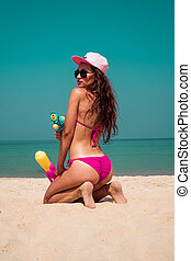 Beautiful young girl with water gun