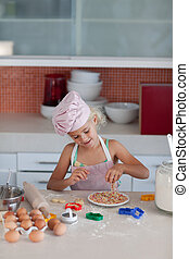 Beautiful young Girl Working in the Kitchen