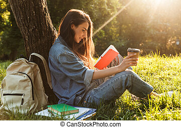 Beautiful young girl writing in a notepad