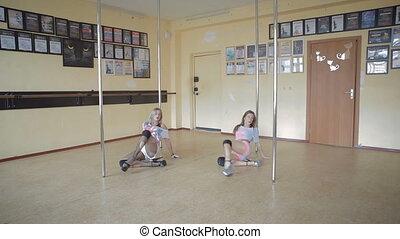 Beautiful young girls Pole dance studio stock footage video...