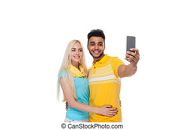 Beautiful Young Happy Couple Love Smiling Embracing Taking Selfie Photo On Cell Smart Phone, Hispanic Man Woman