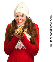 Beautiful young happy woman  holding small gift