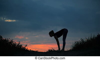 Beautiful young healthy woman doing yoga exercise