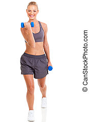 young healthy woman exercising with dumbbells