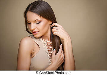 Beautiful young healthy woman is very shy