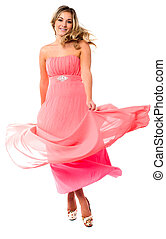 Beautiful young in fluttering party dress