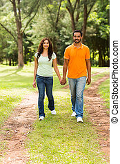 young indian couple walking outdoors
