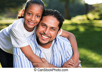 young indian girl with her father outdoors