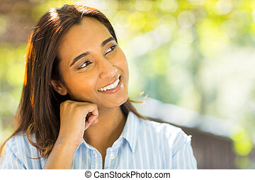 young indian woman daydreaming