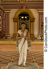 Beautiful young indian woman in traditional clothing with bridal