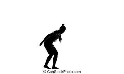 Beautiful young lady dancing social latin dance, slow motion, silhouette