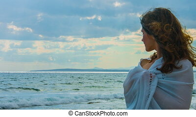 """""""Beautiful young lady on beach looking at horizon, thinking of love, romance"""""""