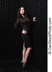 Beautiful young lady posing in the studio.