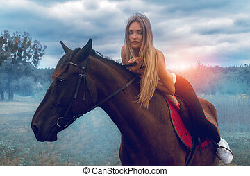 beautiful young lady posing on horseback