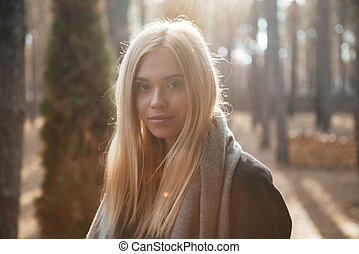 Beautiful young lady standing outdoors in the forest