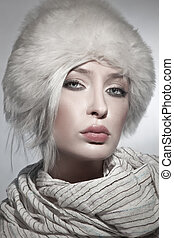 beautiful young lady wearing fur hat