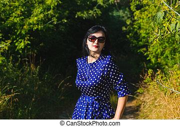 Beautiful young lady wearing long dress