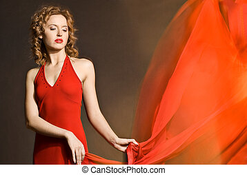 Beautiful young lady wearing red dress