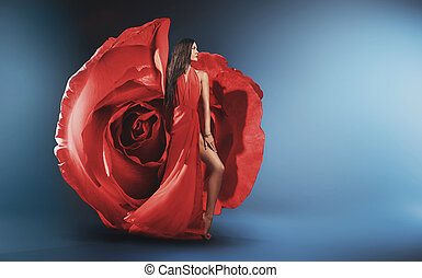 Beautiful young lady wearing rose gown
