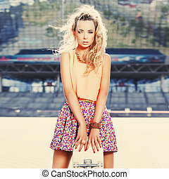beautiful young lady with a skateboard with blank deck - ...