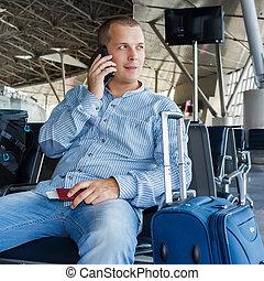 beautiful young man at the airport