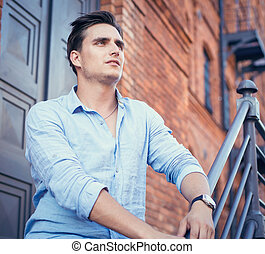 young man on the brick wall
