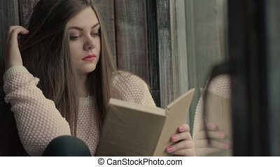 Beautiful young model read a literature turning pages of the book