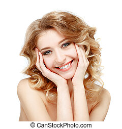 Beautiful young model smiling on a white background.