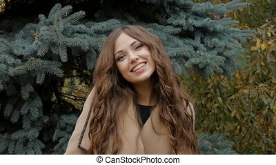 Beautiful young model smiling photographer