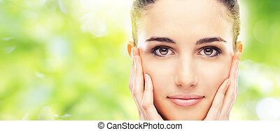 Beautiful young model touching her skin - Beautiful female...