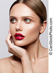 Beautiful young model with red lips