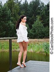 Beautiful young naked woman near a small pond - Beautiful...
