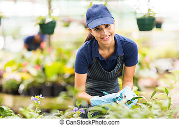 young nursery worker gardening