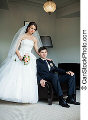 beautiful young photographed the bride in the room