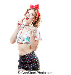 Beautiful young pinup woman holding sunglasses and looking in camera isolated on white background