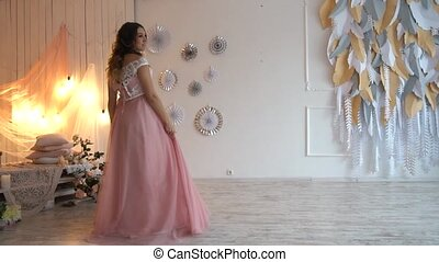 beautiful young pregnant girl in pink dress