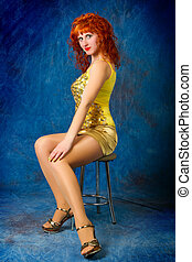 young red-haired girl in a yellow dress