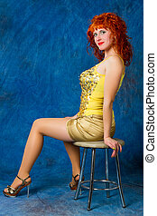 girl in a yellow dress on a blue background
