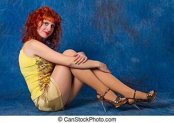 red-haired girl in a yellow dress